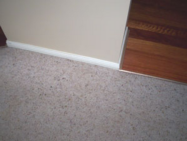 An image showing the repaired carpet runner on stairs.